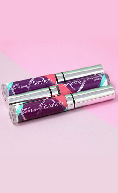 BoostLash Eyelash Growth Serum on Pink Background